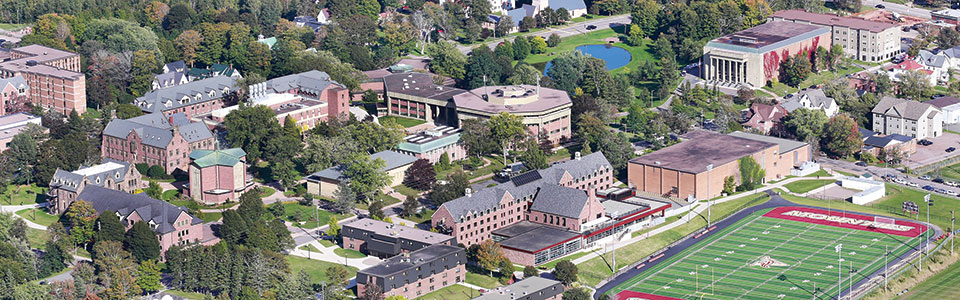 Mount Allison University campus: brick buildings and students walking and seated.