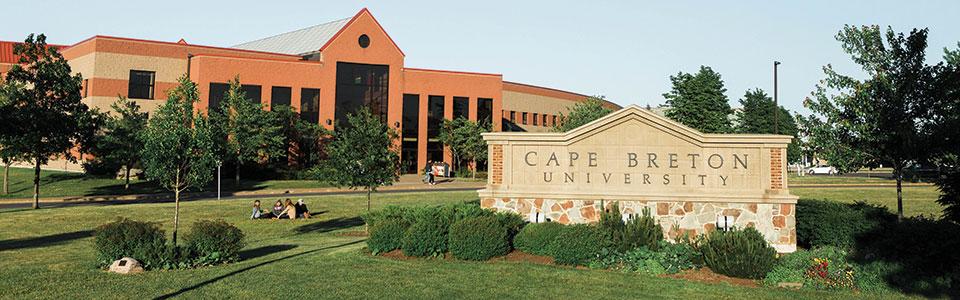 Cape Breton University campus: three smiling students.