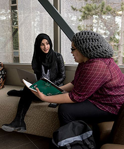 Mount Saint Vincent University-two students on couch talking