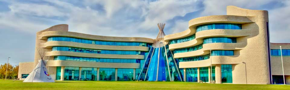 First Nations University of Canada campus: modern curvaceous building with teepee-shaped centre.
