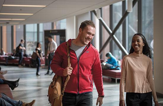 Ryerson students walking in hallway.