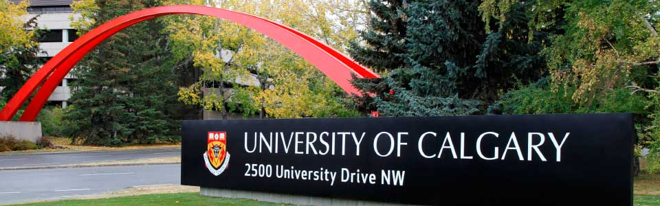 University of Calgary campus: university entrance with red arch over the road.