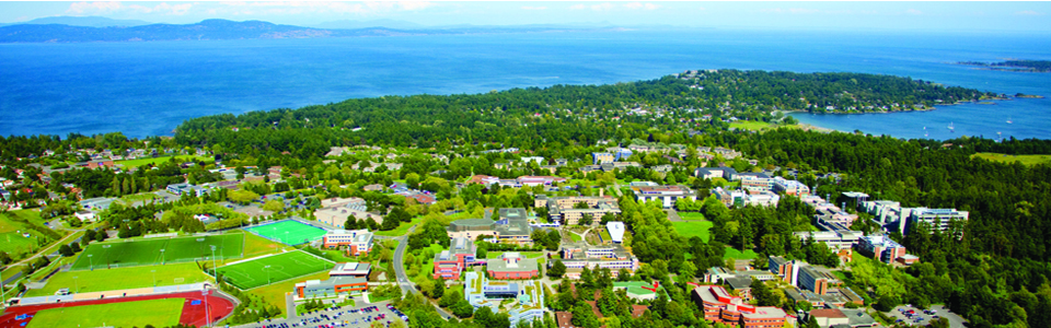 University of Victoria campus: aerial shot of campus with ocean in background.