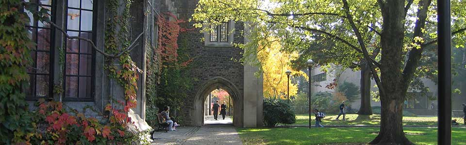 Victoria University campus, Toronto: stone building with archway.