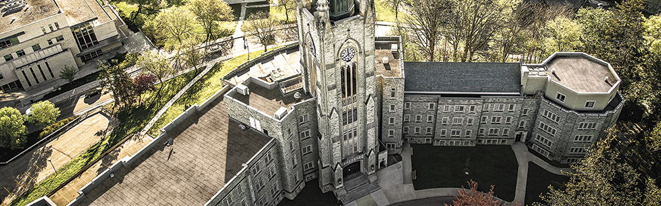 Western University campus: aerial shot of stone tower and surrounding buildings.