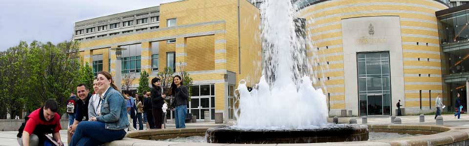 York University campus: building with fountain out front.